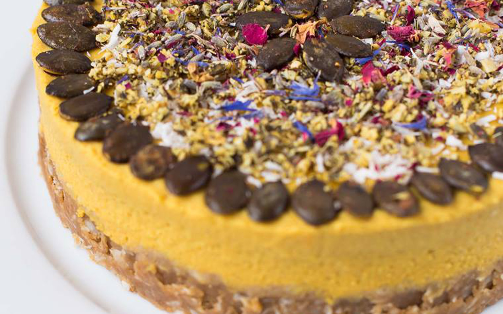 Vegan Golden Milk Pie with sweet potatoes with colorful toppings